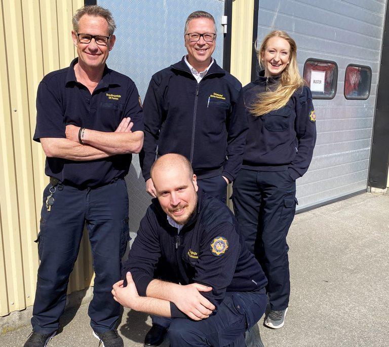 Fyra medarbetare från NÄRF:s enhet samhällsskydd. Glada miner.
